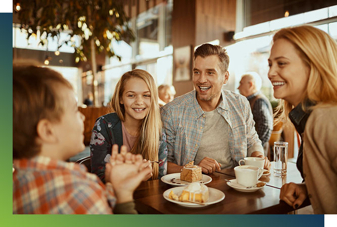 Family having cake an coffee at a restaurant